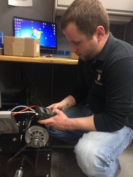 Nonstop Locksmith Tech programing 100 remotes for a high speed commercial door for installation